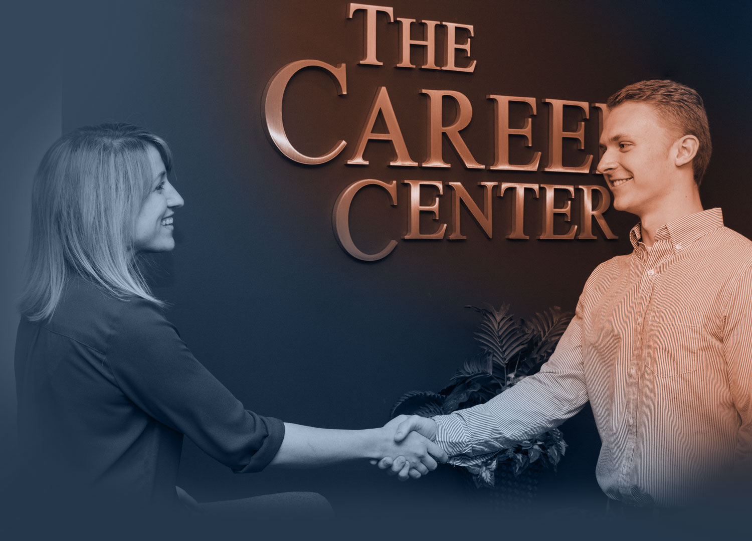 Two people greeting one another at the Career Center