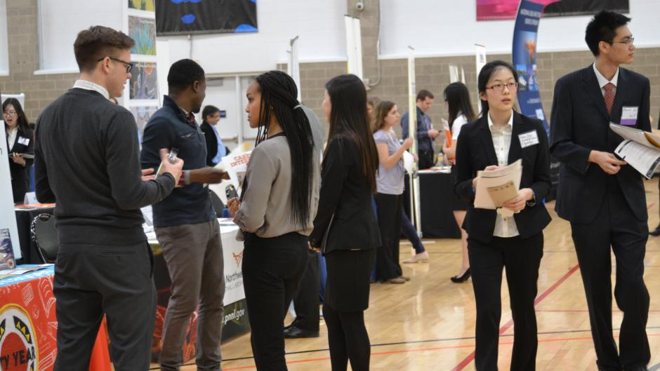 Students speak with recruiters during a career fair held in the Activities and Recreation Center