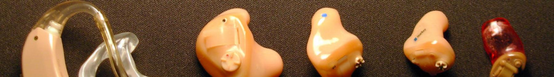 A lineup of five different types of hearing aids