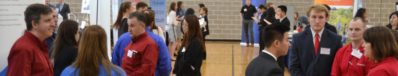 Students engage with recruiters from Chamberlain Group and Behring at a career fair.