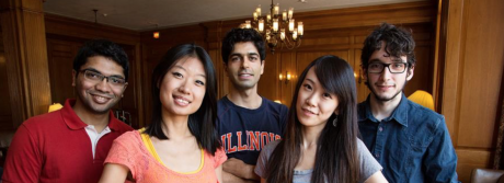 Five students posing and smiling