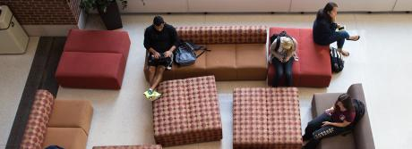 Students relax in the lobby of the Student Dining and Residential Programs Building.